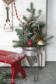 faux to real mini christmas tree in a strainer wood presentfunky
