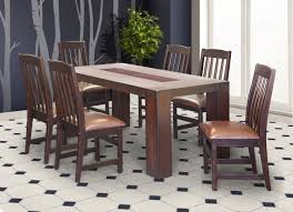 a beautiful black 6 seater dining room table for and 6 digame for