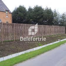 terrasses et jardin clôture en noisetier tressé naturel delefortrie paysages