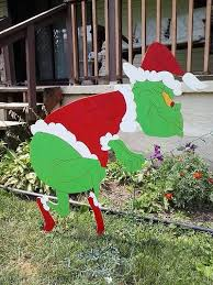 grinch sneaking grinch stealing lights outdoor wood yard