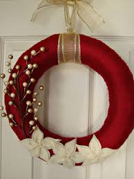 dark red yarn wrapped wreath with 3 layer poinsettia 30 00 via