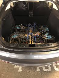 tesla inside engine tesla model s owner builds mining rig in trunk of car viral docks