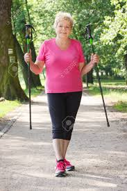elderly woman clothes elderly senior woman in sporty clothes practicing nordic walking