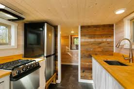 craftsman style tiny home featuring cedar siding and reclaimed