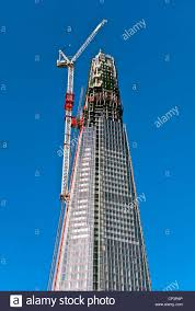 crane attached to the side of the nearly completed shard building
