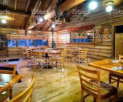 american western log cabin restaurant dining room interior stock