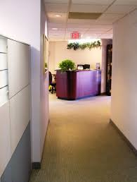 office reception desk with accent indirect up light fixture