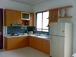 interior in kitchen appliances glass tile backsplash with top freezer fridge also