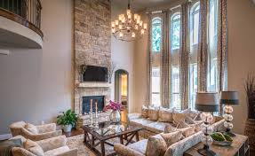 transitional living room design with high ceiling and lcd tv