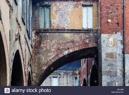 contrasting architectural styles on the streets of milan italy