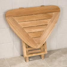 bathroom teak shower bench with x legs on travertine tile floor