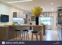 modern stools kitchen modern bulthaup kitchen with breakfast bar and stools stock photo