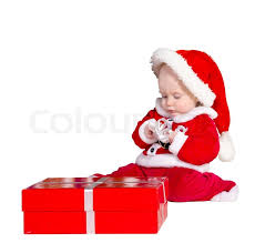 baby boy christmas baby boy wearing santa s costume sitting and holding a box