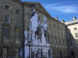 powerful new mural by street artist joe caslin covers trinity the volunteers mural at trinity by joe caslin