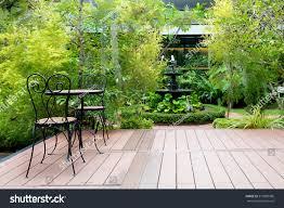 Chair In Garden Black Chair Wood Patio Green Garden Stock Photo 519960586