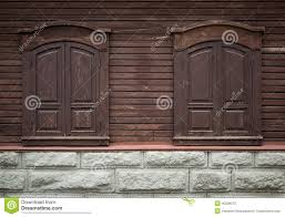 wooden window with carved wooden ornaments closed windows