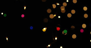 black colored christmas lights christmas colorful bokeh lights moving on a black background close