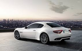 2017 maserati granturismo white white maserati granturismo in a parking lot above the city