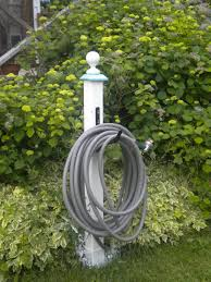 diy garden hose hanger with 4 x 4 painted wood finial hardware