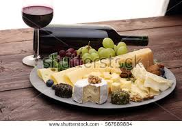 wine bottle cheese plate cheese platter different cheese grapes stock photo 567689884