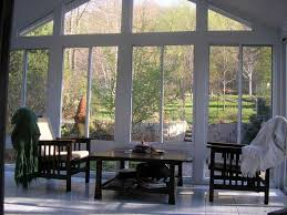 interior simple sunroom decor with bold solid hardwood chairs