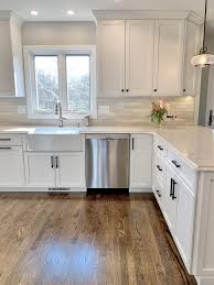 white kitchen cabinets with farm sink 6 types of kitchen sinks dean cabinetry