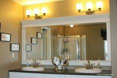 framing bathroom mirrors with crown molding inexpensive and easy way to upgrade your plain bathroom mirror use