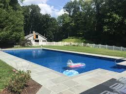 create pool paradise with unilock patios landwork contractor