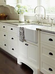 white kitchen cabinets with farm sink these white kitchens are anything but boring white kitchen