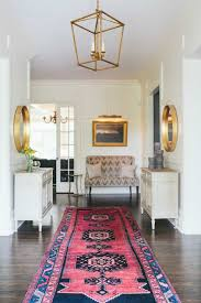 entryway colors long colorful rug runner into a neutral and gold foyer kate