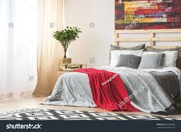 grey bed red blanket modern cozy stock photo 606921668 shutterstock