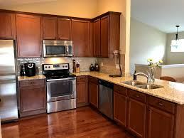 what to do with brown kitchen cabinets how to easily add hardware to cabinets building dreams