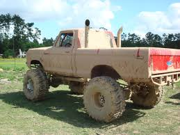 monster trucks videos in mud mud trucks throttle junkie performance love those stacks