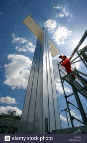 25 Square Meters To Feet by A Worker Hammers Next To A Cross 21 Meters 69 Feet High And 7