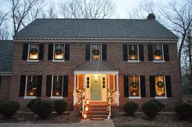 holiday window candle lights outdoor holiday decorating the easy way to hang window wreaths in