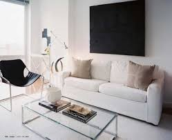 living room white walls with black wall art and side chair