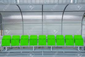 green reserve and staff coach bench in sport stadium stock photo