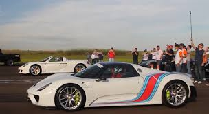 classic porsche spyder porsche 918 spyder vs porsche carrera gt drag race shows the