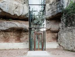 beautiful brick and glass elevator connects old and new parts of