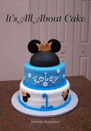 baby shower prince cake and a mickey mouse smash cake piece of