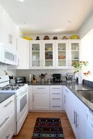 kitchen brown wood flooring white hanging lamps brown wood