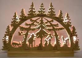 schwibbogen thin wood is hand sawn to make a scene displayed with