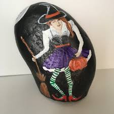 the witch is in painted halloween rock project by decoart