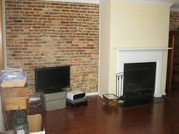 Fireplace Wall Decor by Fab Classic Family Room Decor With Exposed Brick Wall Also White