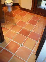 12x12 traditional terra cotta tiles with a 2x2 insert cut on site