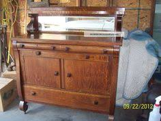 antique sideboard refinished this same piece 30 yrs ago used as