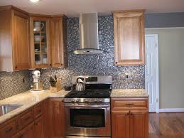Glass Kitchen Backsplash Tile L Shaped Cabinetry With Black Granite Countertop With Grey Mosaic