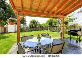 pergola patio area glass top table stock photo 219872236