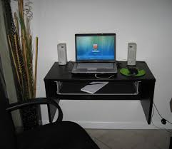 Floating Corner Desk by Corner Black Wooden Desk With White Top And Keyboard Plus Cpu