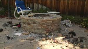two girls injured when barbecue pit exploded in backyard of home